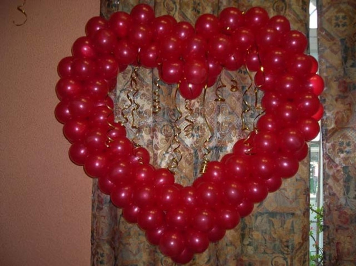 Как сделать из длинных шаров сердечки
